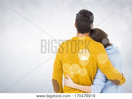 Rear view of couple embracing each other against digitally generated white background