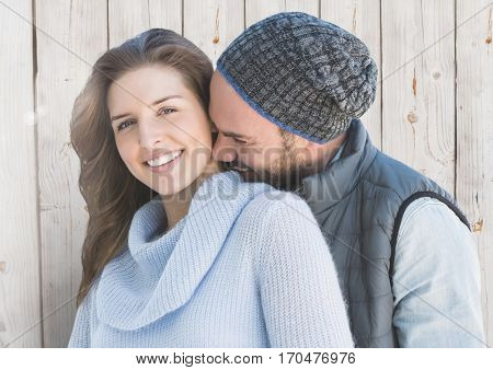 Romantic couple embracing each other against wooden background