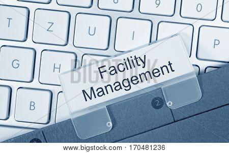 Facility Management - folder with text on computer keyboard