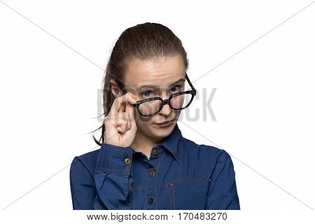 Portrait of grumpy woman in glasses on white background