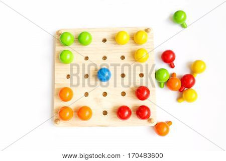 Colored Pegs Board, Wood Beads On White Background