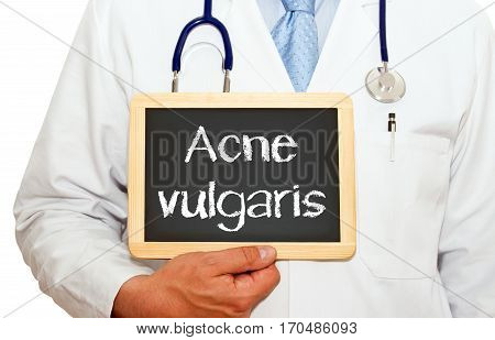 Acne vulgaris - Doctor with chalkboard on white background