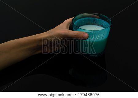 Woman hand holding a glass of kefir