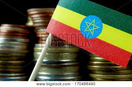 Ethiopian Flag Waving With Stack Of Money Coins Macro