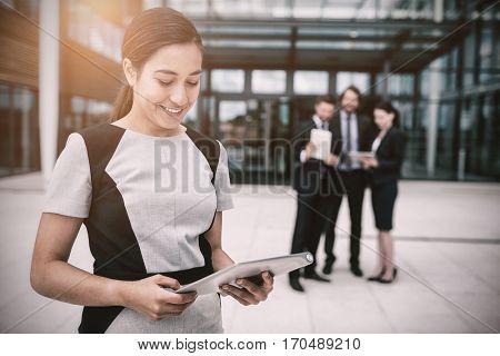 Businesswoman holding digital tablet in office premises