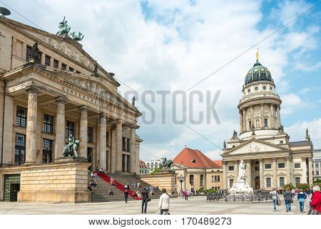 BERLIN, GERMANY- May 18, 2014: The Gendarmenmarkt is a square in Berlin, and the site of the Konzerthaus and the French and German Cathedrals. May 18, 2014 in Berlin