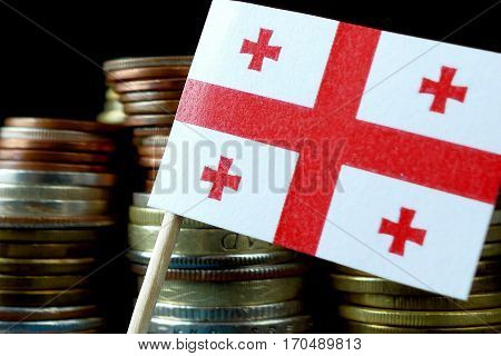 Georgian Flag Waving With Stack Of Money Coins Macro