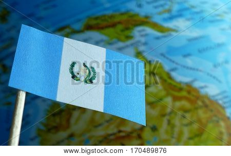 Guatemalan Flag With A Globe Map As A Background Macro