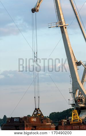 small crane working in bay loading sand
