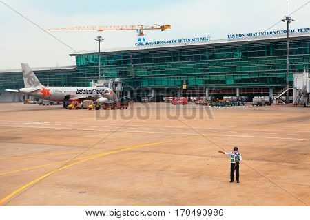 Ho Chi Minh Vietnam - September 5 2015: Aircraft of asian low cost airline Jet Star Air preparing for flight in front of passenger terminal building in Ho Chi Minh ( Saigon ) International Airport.
