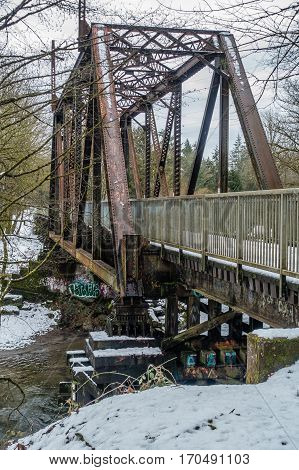 A view of a rusted bridge trestle above the Cedar River in Renton Washington.