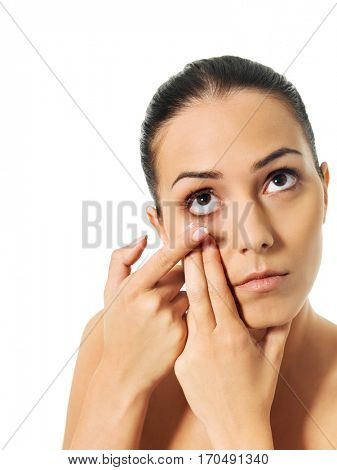 Young woman wearing contact lens
