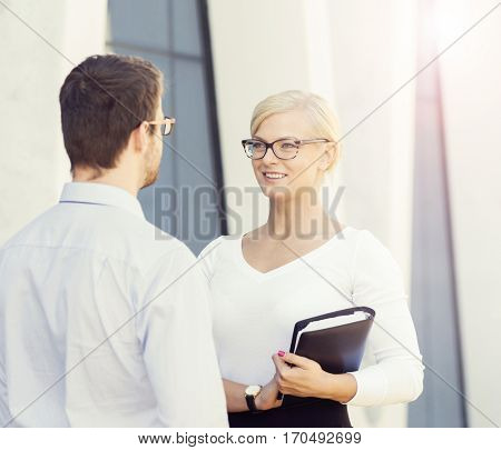Man and woman in formalwear in the street. Businessman and businesswoman. Outdoor business concept.
