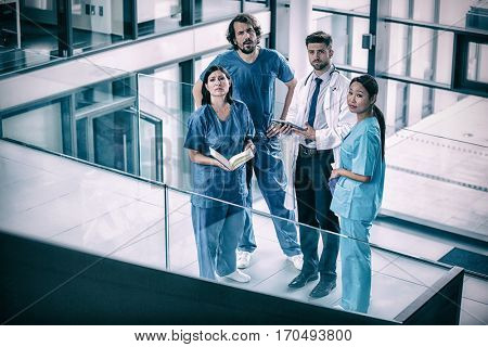Portrait of doctor and nurse standing in hospital