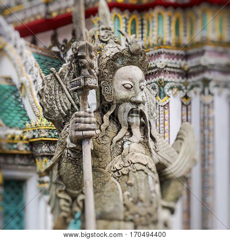 Statue of a Chinese warrior near an entrance of Wat Pho. Wat Pho is a Buddhist temple complex in the Rattanakosin district of Bangkok.