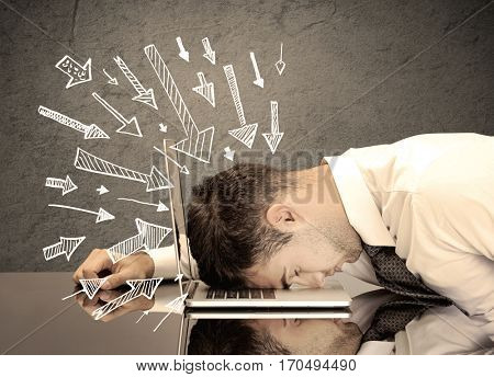 An exhausted business person resting his head on keyboard with pressure illustrated by arrows pointing at him concept