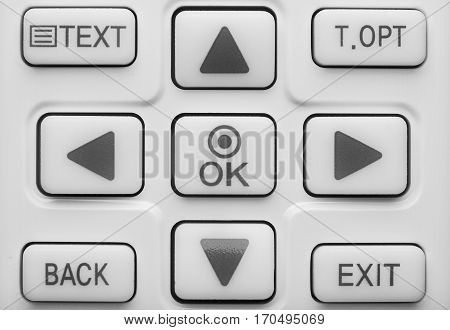 Conceptual image. Part of the TV remote with up down right left arrows