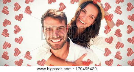 Man doing piggy-back to girlfriend