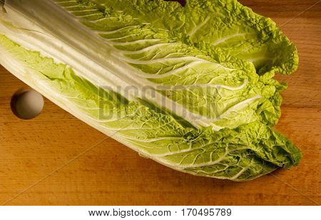 Chinese cabbage on the wooden kitchen board