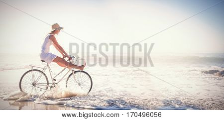 Woman riding bike in the sea