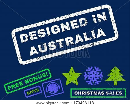 Designed In Australia text rubber seal stamp watermark with additional bonus new year symbols. Caption inside rectangular shape with grunge design and dirty texture.
