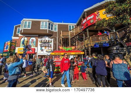 San Francisco, California, United States - August 14, 2016: Tourist crowd in shops and restaurants of shopping center at Pier 39, Fisherman's Wharf. Leisure, recreation, lifestyle and holidays concept