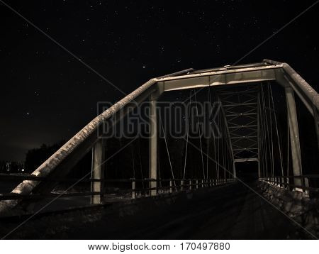 Bridge on a river in the night, nort of Sweden