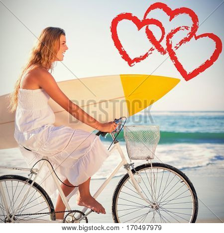 beautiful surfer in sundress on bike holding surfboard at beach