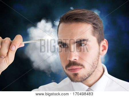 Man connecting cable to the cloud showing computing concept