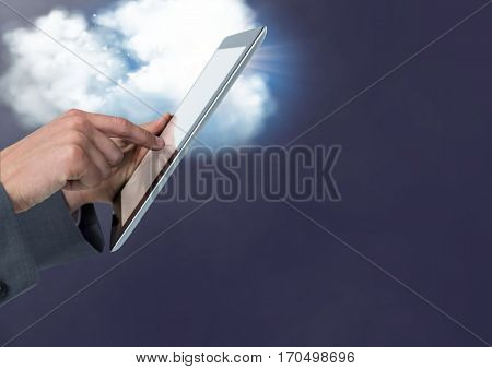 Hand of businessman using digital tablet against digitally generated cloud background