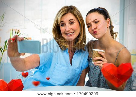 Hearts against mother taking selfie while daughter puckering 3D