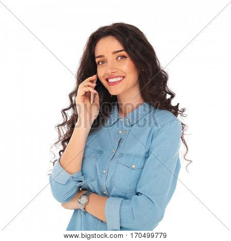relaxed smiling woman talking on the phone on white background