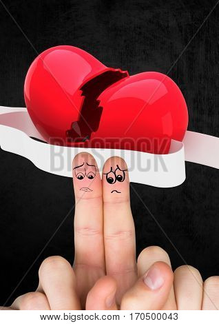 Composite image of sad finger couple with red broken heart.