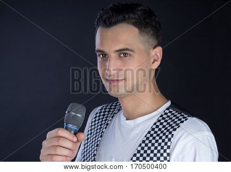 Male Black-haired Pop Singer Performs Singing To Microphone