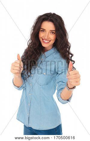 happy casual woman making the ok thumbs up hand sign on white background
