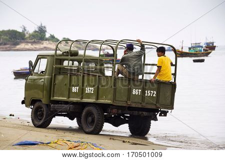 Mui Ne, Vietnam - February 7: Fishermen Driving Car On Beach With Colorful Fishing Boats On February