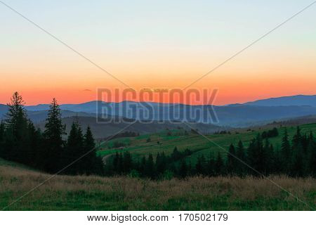 Sunrise in mountains. The sky is red.