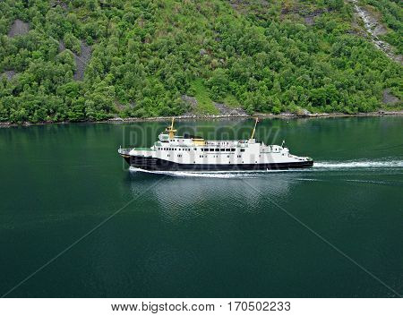 Geiranger, Norway - June 3, 2009: A ferry of the shipping company Fjord1 on the Geiranger fjord in Norway.