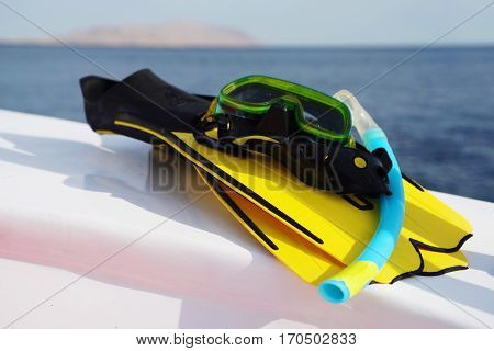 Fins mask on board. Snorkeling Red Sea