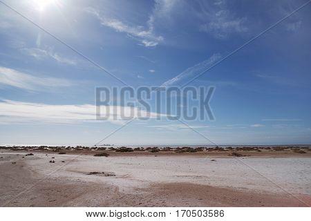 Deserted beach, sunny day, a mirage, Sea coast, surf,  beautiful sky