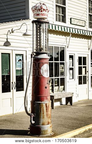 Glen Arbor, Michigan, August 8, 2016: Vintage fuel pump on a street in Glen Arbor, Michigan