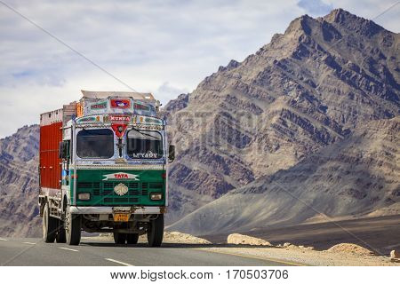 Kashmir, India - July 10, 2016: Traditionally decorated Tata truck on the road in Kashmir, India