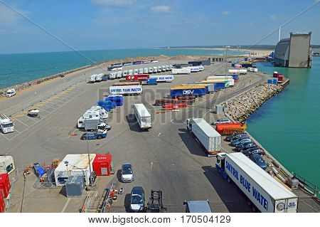 Hirtshals, Denmark - May 31, 2014: Trucks and buses waiting in the parking lot of the ferry terminal on the loading onto a ferry to Iceland and the Faroe Islands.