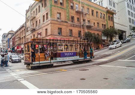 SAN FRANCISCO, Ca, OCTOBER, 09,2015: Passengers ride in a cable car the most popular attraction of San Fransisco.