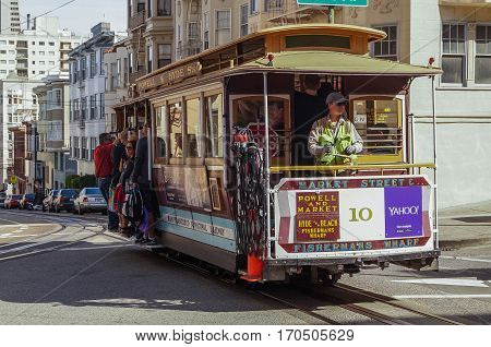 SAN FRANCISCO; Ca; OCTOBER, 09;,2015: Passengers ride in a cable car the most popular attraction of San Fransisco.