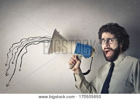 Man talks to megaphone but his voice lets low poster