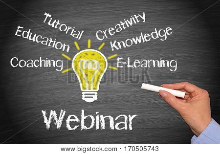 Webinar - online e-learning seminar concept with light bulb and text
