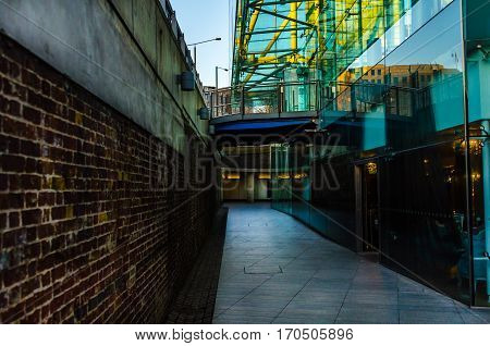 interesting architecture in the underground passage a combination of old brick with modern glass a combination of old and new