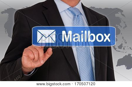 Mailbox - Businessman with touchscreen on world map background