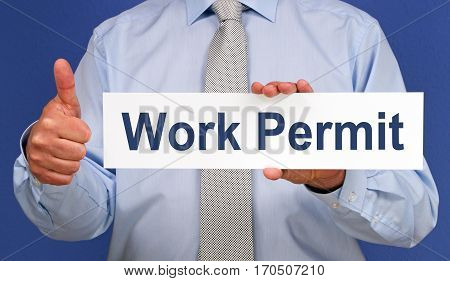 Work Permit - Businessman with sign and thumb up